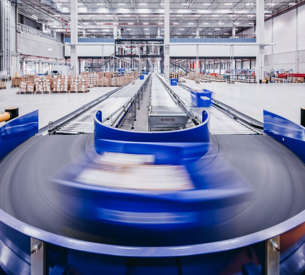 Package on conveyer band inside TTI warehouse